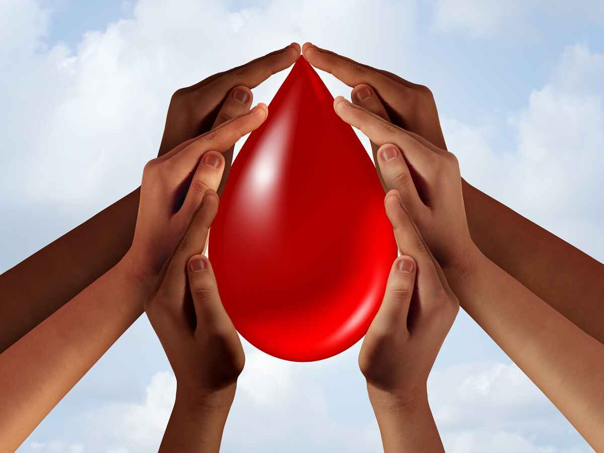 hands holding large blood drop